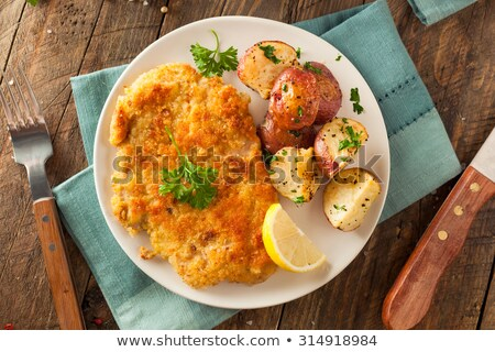 Weiner schnitzel with fried potatoes  Stock photo © grafvision
