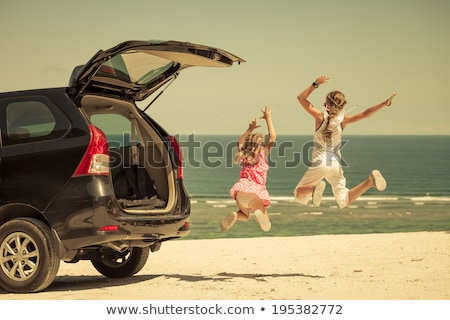 Girl near the beach sitting on the car Stock photo © iko