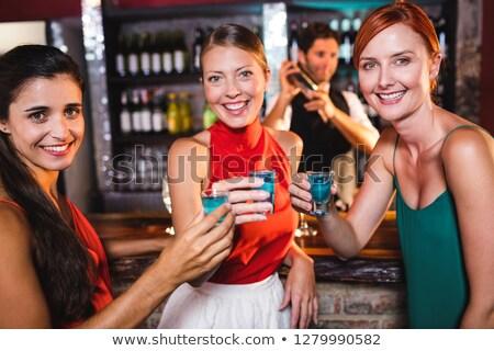 Portré női barátok élvezi tequila éjszakai klub Stock fotó © wavebreak_media