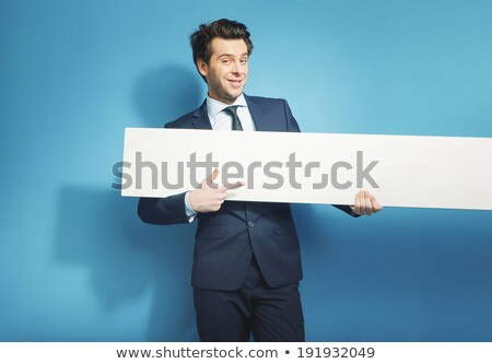Overjoyed businessman holding empty horizontal  panel. Stock photo © lichtmeister