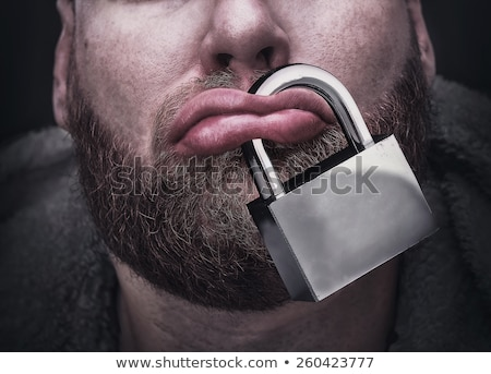 Man silenced with locked mouth by a padlock. Stock photo © lichtmeister