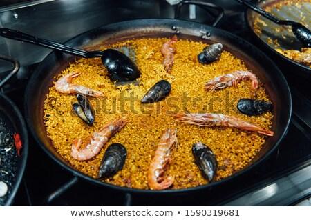 Spanish food. Gold paella. San Miguel seafood market in MADRID Stock photo © ruslanshramko
