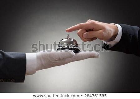 Férfi pincér tart szolgáltatás harang kéz Stock fotó © AndreyPopov