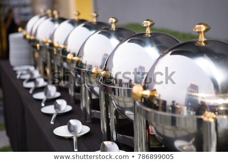 Buffet lunch with chafing dishes and dinnerware Stock photo © przemekklos
