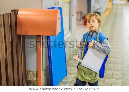 мальчика почтальон человека город счастливым двери Сток-фото © galitskaya