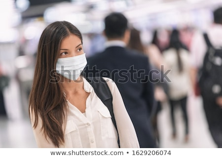 Coronavirus corona virus Asian woman wearing flu mask walking on work commute in public space transp Stock photo © Maridav