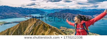 Hiker jumping of joy funny - panoramic banner of woman hiking in New Zealand laughing having fun, jo Stock photo © Maridav