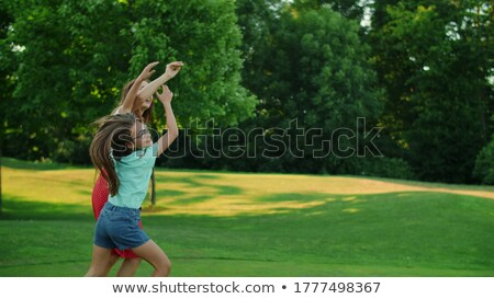 mother and son playing catch game at summer park Stock photo © dolgachov