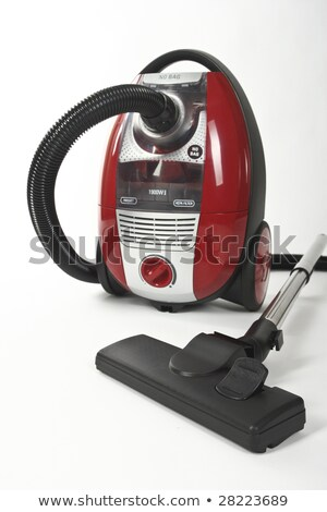 The red vacuum cleaner with a black hose on a white background Stock photo © vlaru