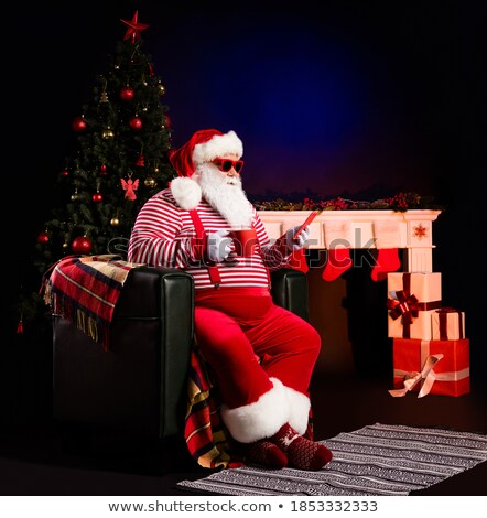 Old fashioned black telephone with Santa's hat Stock photo © AndreyKr
