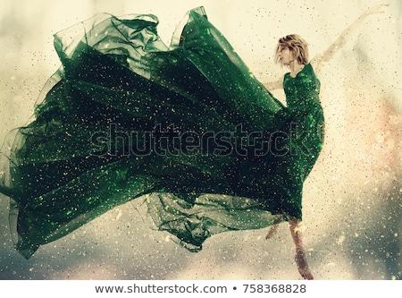 улыбаясь · брюнетка · женщину · зеленый · платье · Постоянный - Сток-фото © keeweeboy