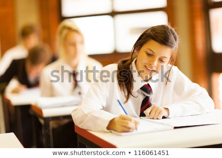 cute smile teenage student girl in school uniform stock photo © darrinhenry