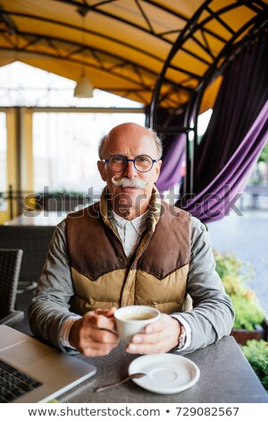 Elderly man having an espresso on a terrace Stock photo © photography33