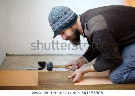 Handy-man laying wooden flooring Stock photo © photography33