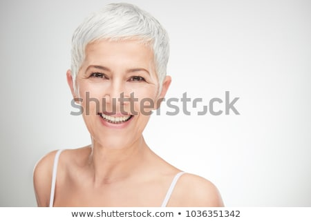 Grey-haired woman on white background Stock photo © photography33