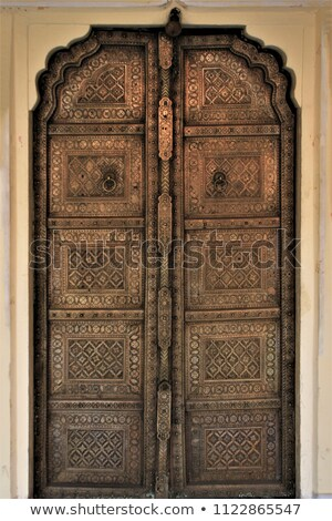old wood and brass door in jaipur india stock photo © calvste