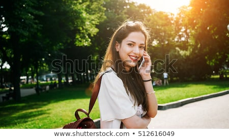 gorgeous young brunette student outdoors stock photo © lithian