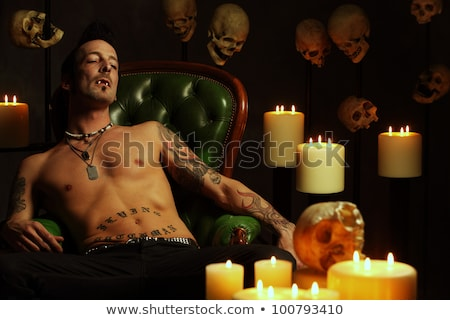 Male vampire sitting on leather chair Stock photo © sumners