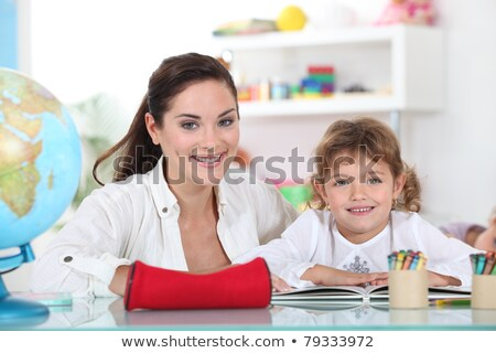 little girl sat with teacher in class room stock photo © photography33