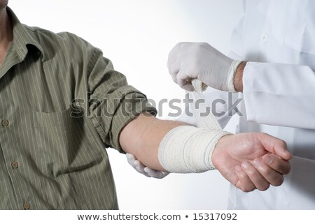 Doctor examining the arm of his patient in a room Stock photo © wavebreak_media