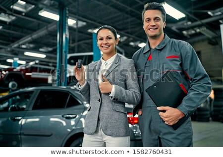 Female mechanic showing thumbs up stock photo © wavebreak_media