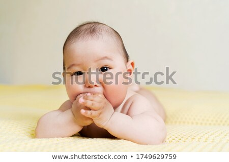 Young girl holds a finger to his mouth Stock photo © w20er