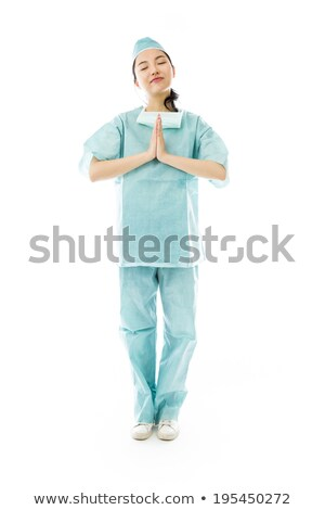 Asian female surgeon praying with hands clasped Stock photo © bmonteny