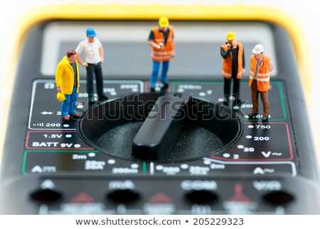 Team of miniature workers on top of multimeter. Macro photo Stock photo © Kirill_M