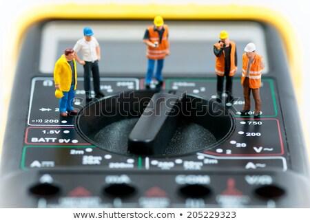 Team of miniature workers on top of multimeter. Macro photo Stock photo © Kirill_M