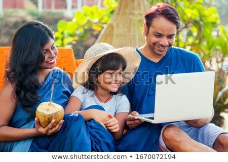 lecture · livre · électronique · plage · homme · ordinateur · soleil - photo stock © nito