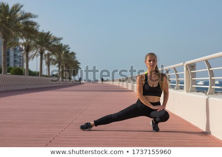 Stock photo: Portrait Of Beautiful Woman Doing Stretching Exercise