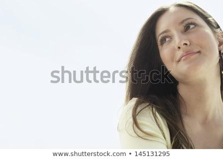 Közelkép fiatal üzletasszony másfelé néz fényes iroda Stock fotó © wavebreak_media