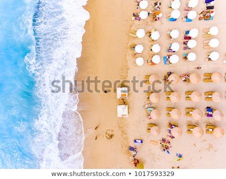 Grécia · guarda-sol · praia · sol · mar · azul - foto stock © jonnysek