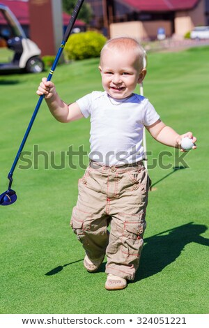 Cute little baby boy playing golf on a field Stock photo © Len44ik