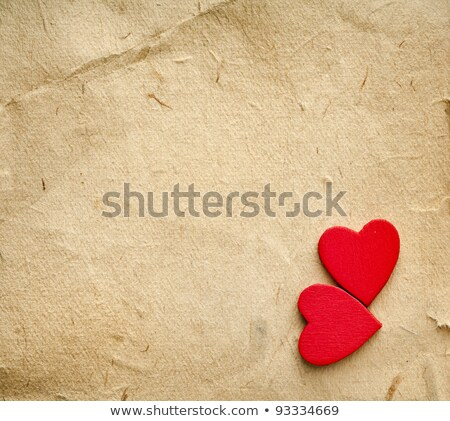 red hearts on vintage paper background with copyspace stock photo © tetkoren