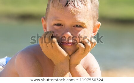 portrait of exhausted boy at the beach Stock photo © meinzahn