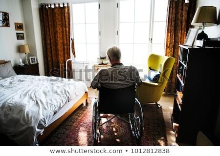 senior man relaxes in the wheelchair  Stock photo © meinzahn