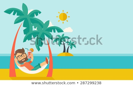 handsome young man on a tropical beach relax on summer vacation stock photo © victoria_andreas