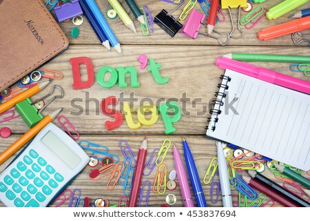 Don't Stop word and office tools on wooden table Stock photo © fuzzbones0
