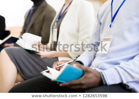 Unrecognizable journalist in press conference room Stock photo © stevanovicigor