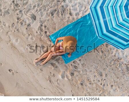 High angle view of woman sunbathing on sand at beach Stock photo © wavebreak_media