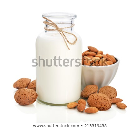 Stock photo: Almond nuts and milk on white background