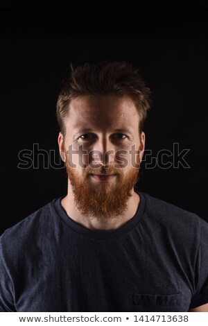 close up portrait of a pensive young redhead man stock photo © deandrobot