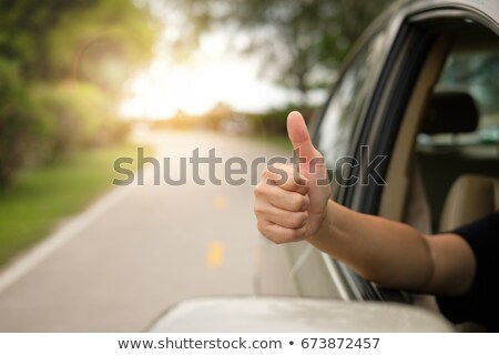 man at window with raised arms Stock photo © IS2