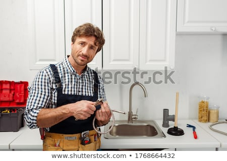 Stock photo: Plumber Holding Plunger Tool
