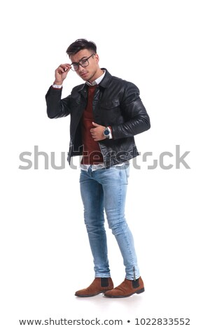 full body picture of a young man fixing his glasses Stock photo © feedough