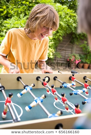 Stock photo: Boy (10-12) playing table football