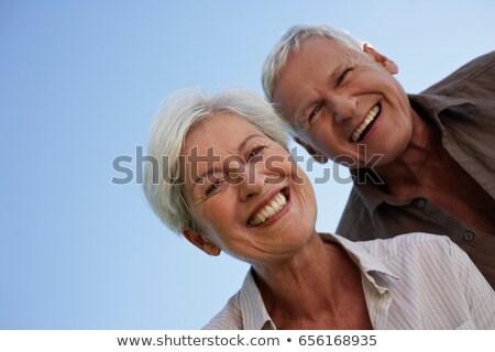 Idős pár görbület kamera szeretet jókedv kék ég Stock fotó © IS2