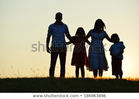 Family standing together outdoors Stock photo © IS2