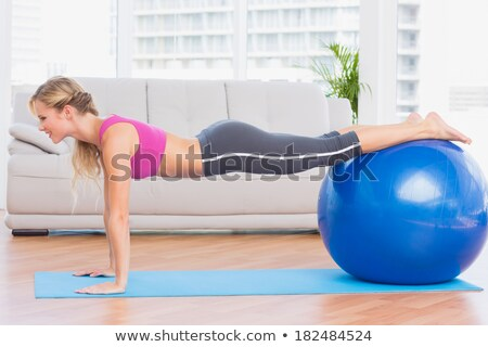 woman using exercise ball stock photo © is2